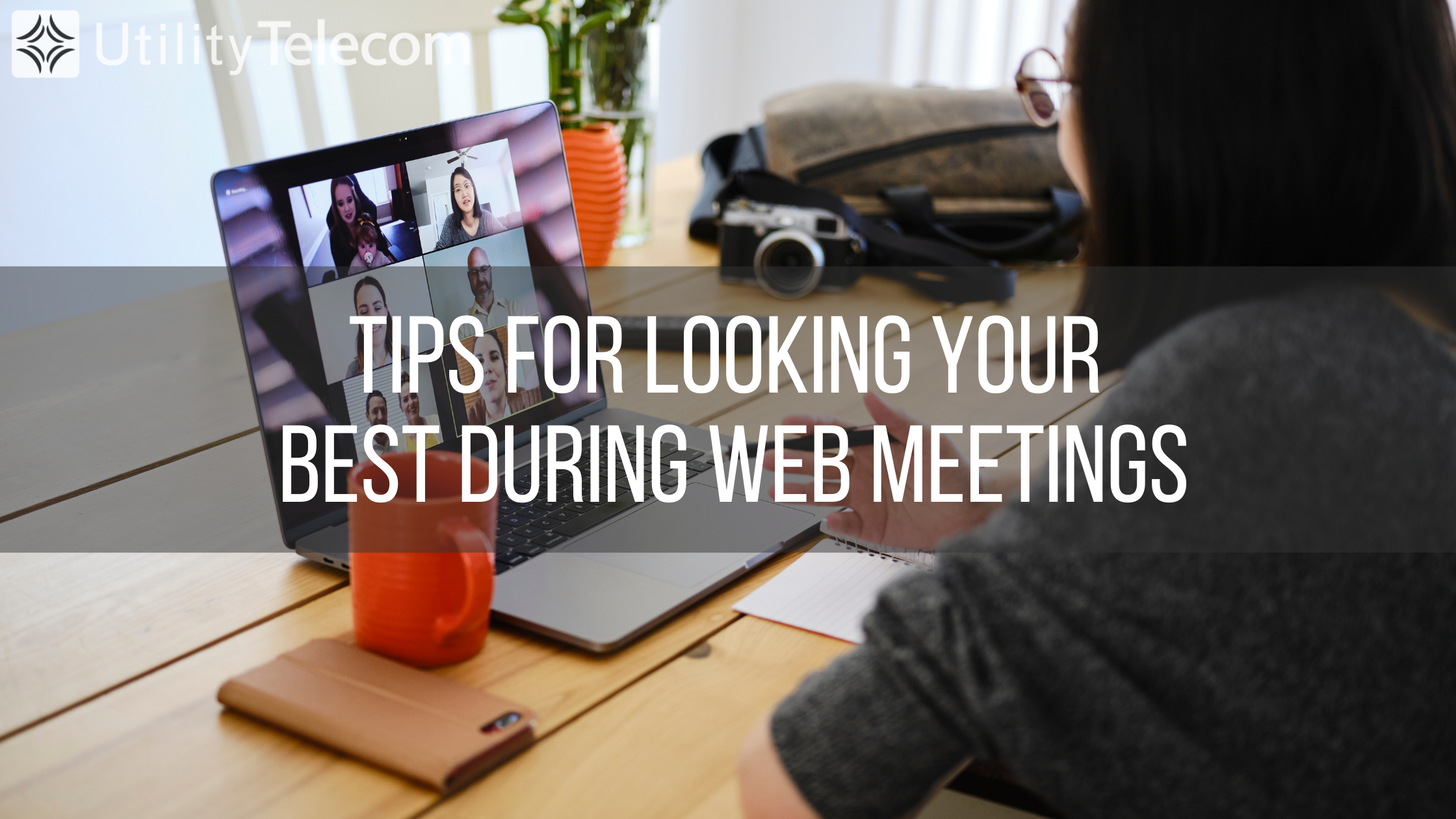 """Woman looking at laptop during a web conference with a text overlay that reads """"Tips for looking your best during web meetings"""""""